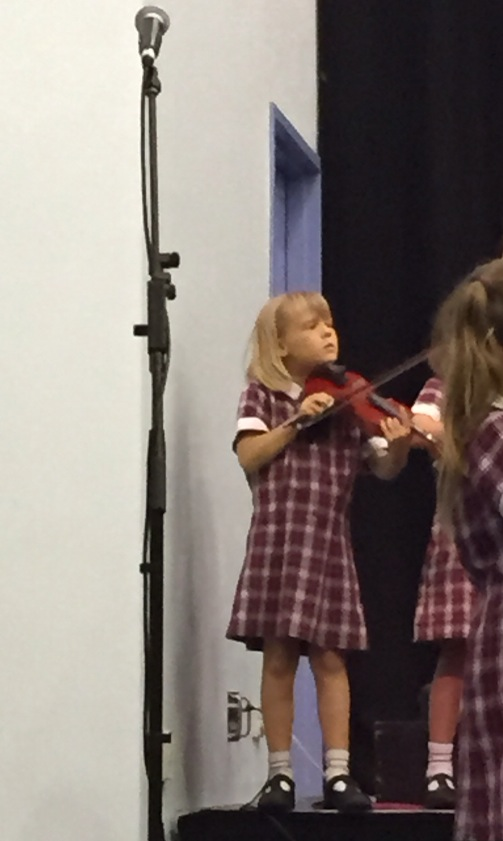 Coco playing the violin